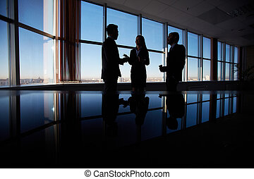 Business conversation - Outlines of three office workers...