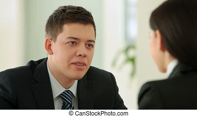 Business conversation - Handsome businessman holding an...