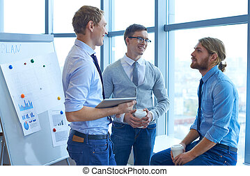 Business conversation - Group of contemporary businessmen...