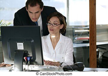 Business couple at a computer