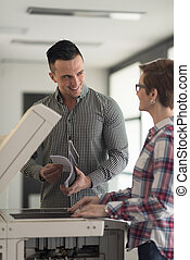 business couple copy documents