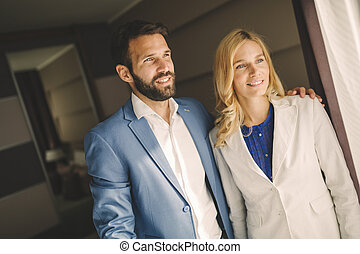 Business couple in formal wear traveling - Business couple...