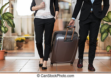 Business Couple In Hotel Lobby, Businesspeople Group Man And Woman Guests Arrive