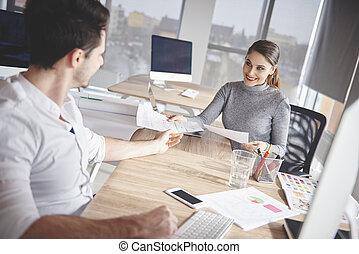 Business couple in modern office