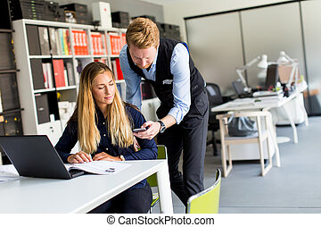 Business couple in office