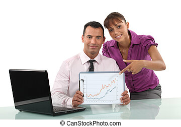 Business couple looking at charts