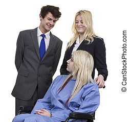 Business Couple Looking At Women Sitting On Wheelchair