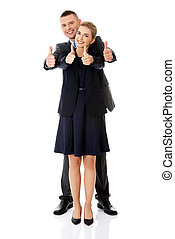 Business couple showing thumbs up