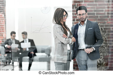 business couple standing in a modern office