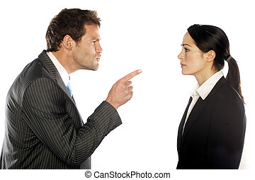business couple looking at each other angrily