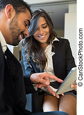 Business couple with tablet