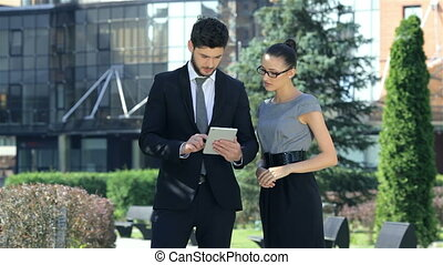 Business couple work standing together, pleasing and discuss success