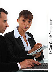 Business couple working on common problem