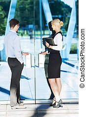 Business couple working outdoors - Businessman and...