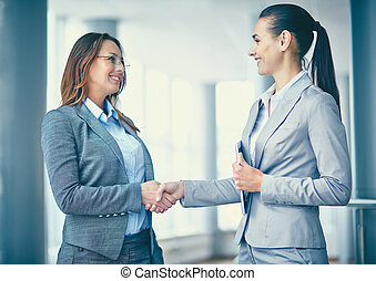 Business deal - Image of two confident businesswomen...