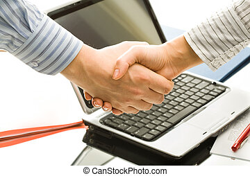 Business deal - Successful handshake to seal a business deal...