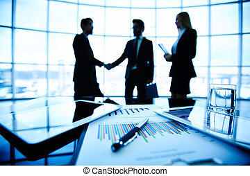 Business deal - Technological devices, financial document...