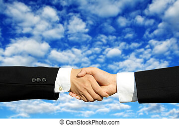 Business deal - Two businessmen shaking hands on a ...