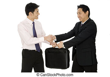 Two young asian businessmen complete a business deal on white background
