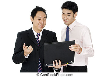 Business Dealings - Two young asian businessmen meeting with...