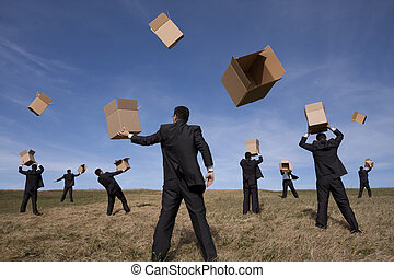 a group of businessmans in the field with cardboard boxes (some motion blur on fast movement)