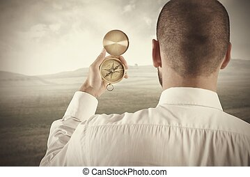 Concept of business direction with businessman and compass