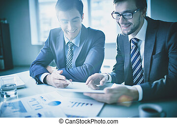 Business discussion - Image of two young businessmen ...