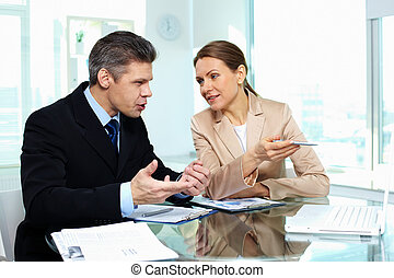Business discussion - Formally dressed young people holding...