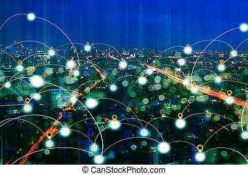Business district at night with network connection technology.