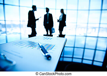 Business document - Image of financial document with pen at...