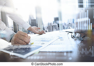 business documents on office table with smart phone and digital tablet and graph business with social network diagram and man working in the background