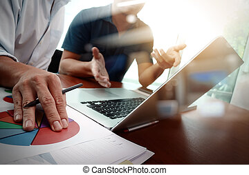 business documents on office table with smart phone and...