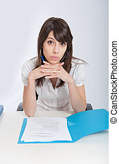 Business documents - Young woman at a desk with a document...