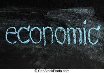 business ECONOMIC written on blackboard
