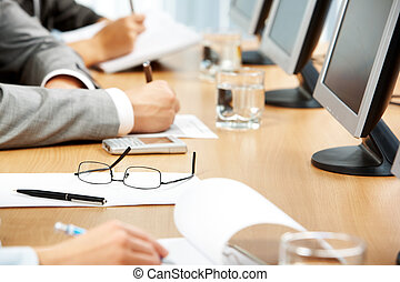 Business education - Image of human hand making notes with...