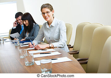 Photo of student sitting at the table at business conference