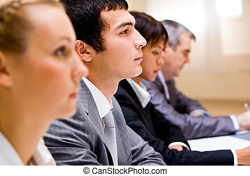 Business education - Image of businessman among his...