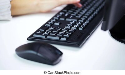 woman hands typing on computer keyboard at office - business...