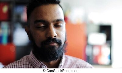 happy smiling man with beard at office