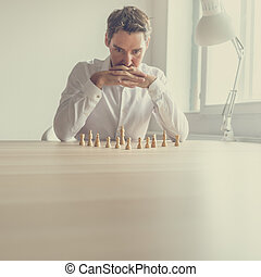 Business employer brainstorming to make the best strategic move