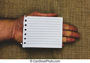 Business Empty template for Layout for invitation greeting card promotion poster voucher Man hand holding piece notebook paper jute background Communicate ideas