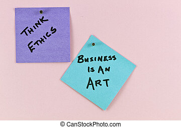 """Two notes posted up indicate ethical role underlying good business strategy and analysis. Philosophical notes read """"Think ethics"""" and """"Business is an art."""""""