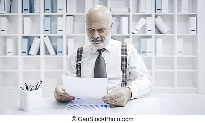 Business executive checking paperwork