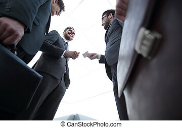 Executives exchanging business cards business executive exchanging business cards colourmoves