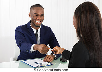 Business Executive Exchanging Business Card - Two Successful...