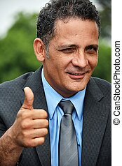 Business Executive With Thumbs Up