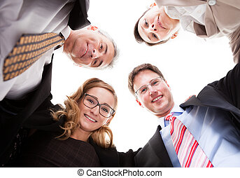 Business executives looking down - Low angle view of four...
