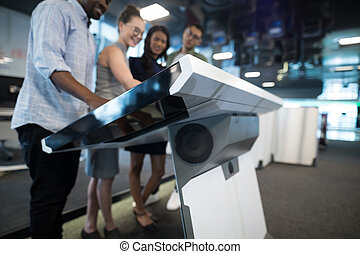Business executives touching digital screen in futuristic ...