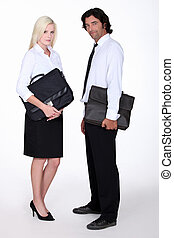 Business executives with briefcases