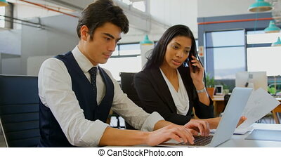 Business executives working in the office 4k